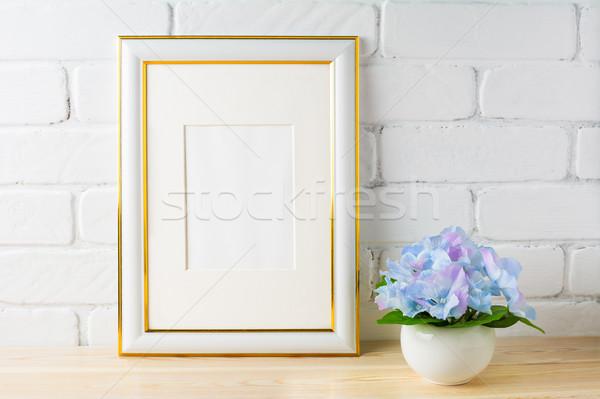 White frame mockup with blue hydrangea Stock photo © TasiPas