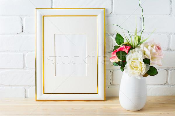 Frame mockup with roses in white vase Stock photo © TasiPas