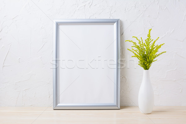 Silver frame mockup with ornamental grass in exquisite vase Stock photo © TasiPas