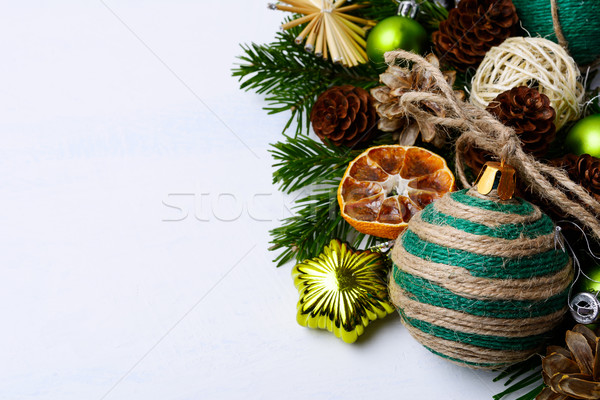 Christmas background with rustic string decorated ornaments and p Stock photo © TasiPas