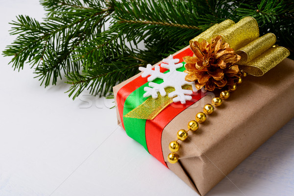 Kraft paper wrapping Christmas gift decorated with snowflake Stock photo © TasiPas