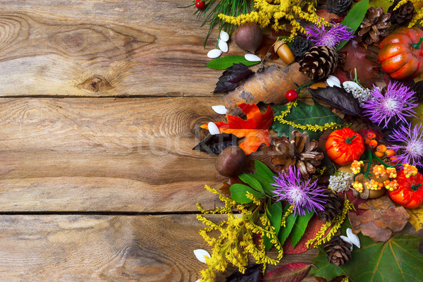 Stock photo: Fall greeting with purple autumn flowers on wooden table
