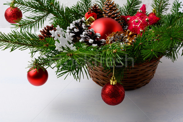 Christmas red ornaments and snowy decorated pine cone table cent Stock photo © TasiPas
