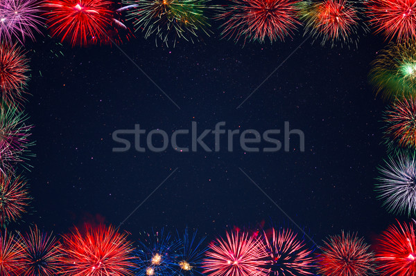 Amazing celebration multicolored sparkling fireworks frame Stock photo © TasiPas