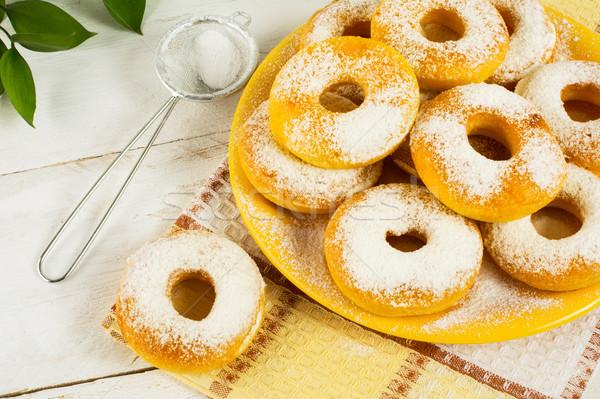 Sweet donuts on yellow plate Stock photo © TasiPas