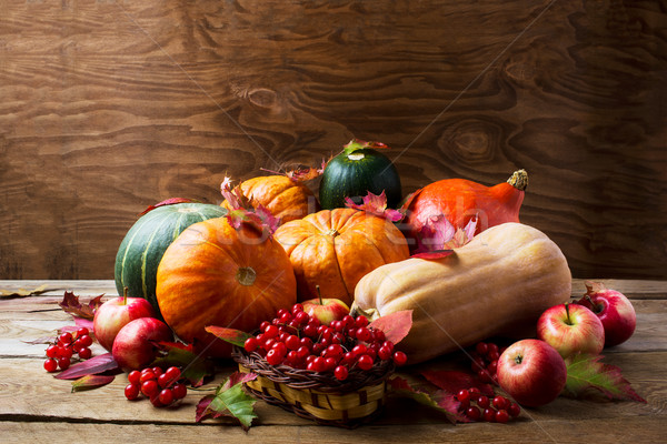 Abundant harvest concept with pumpkins, apples, berries and fall Stock photo © TasiPas