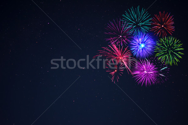 Pink purpe blue green fireworks copy space. Stock photo © TasiPas