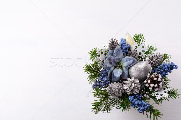 Christmas background with silver glitter decor and blue silk poi Stock photo © TasiPas