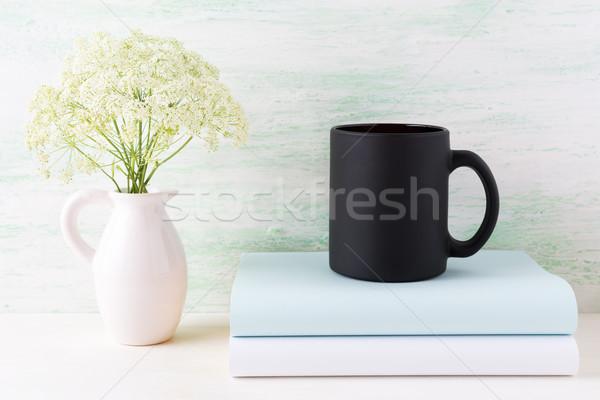 Café noir mug livres tendre fleurs blanches Photo stock © TasiPas