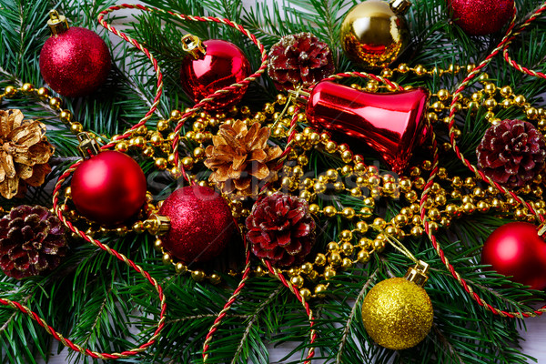 Christmas red ornaments with golden beads and fir branches  Stock photo © TasiPas
