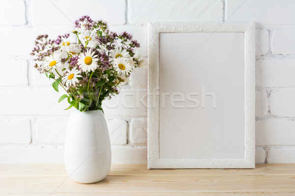 White frame mockup with blooming wildflower bouquet near painted Stock photo © TasiPas