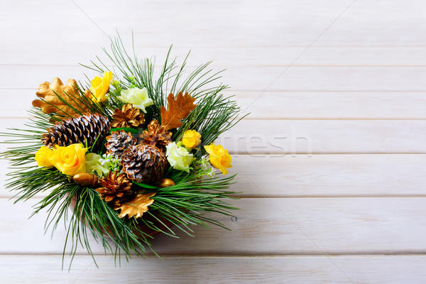 Christmas table centerpiece with pine branches and golden fir co Stock photo © TasiPas