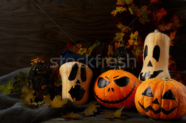 Halloween decorated pumpkins on dark rustic background, copy spa Stock photo © TasiPas