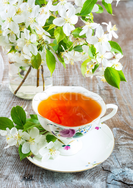 Stock photo: Cup of tea with apple blossom