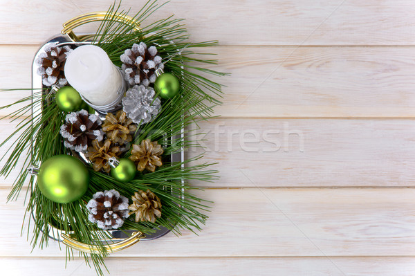 Christmas background with snowy pinecone decorated centerpiece Stock photo © TasiPas