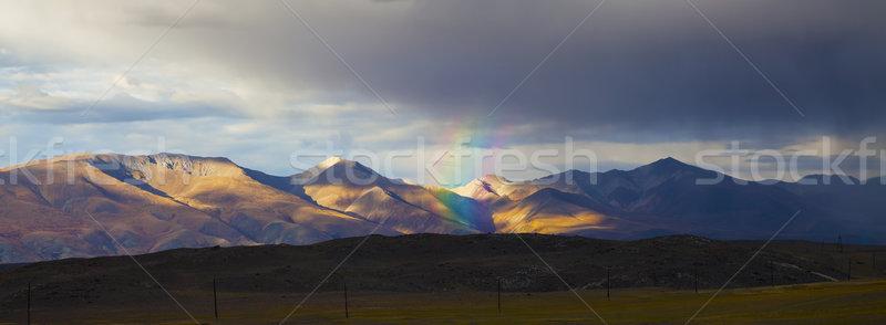 Rainbow in the mountains panorama  Stock photo © TasiPas