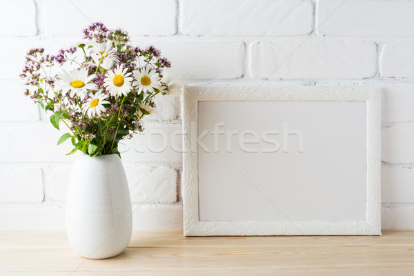 White landscape frame mockup with blooming wildflower bouquet in Stock photo © TasiPas