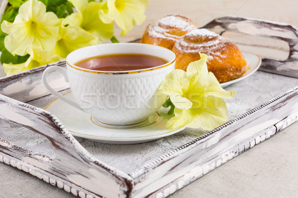 Breakfast Danish pastry and cup of tea on vintage serving tray Stock photo © TasiPas
