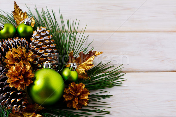 Christmas holiday background with green ornaments and golden con Stock photo © TasiPas