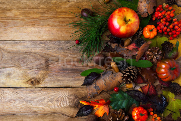 Fall greeting with cones on wooden table Stock photo © TasiPas