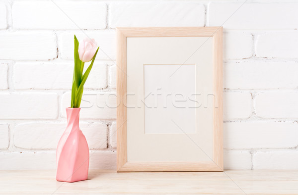 Wooden frame mockup with pink tulip in swirled vase Stock photo © TasiPas