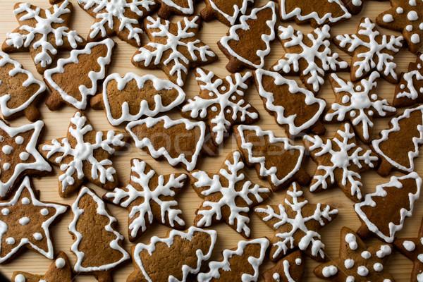 Karácsony sütik cukormáz fény fából készült étel Stock fotó © TasiPas