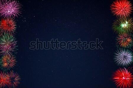 Frame of beautiful celebration fireworks over night sky, copy sp Stock photo © TasiPas