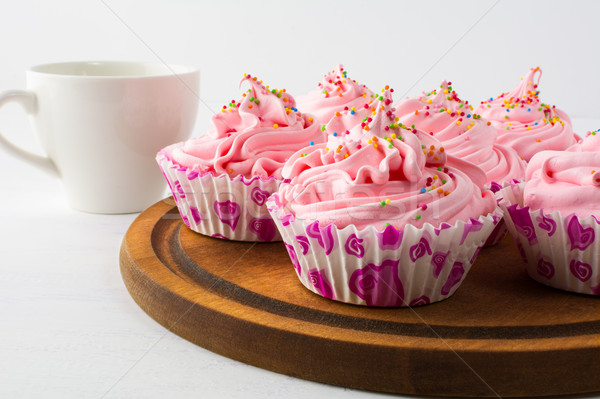 Tea time with pink cupcakes   Stock photo © TasiPas