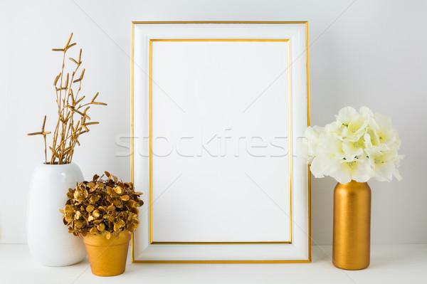Frame mockup with ivory hydrangea in the  golden vase, white vas Stock photo © TasiPas