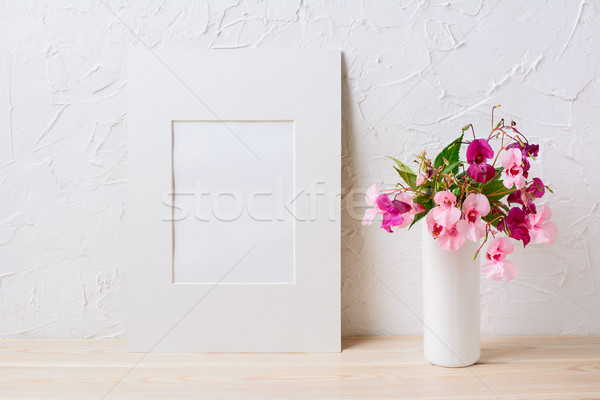 White mat frame mockup with pink and purple flower bouquet Stock photo © TasiPas