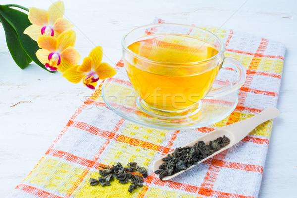 Fincan çay peçete sarı orkide Stok fotoğraf © TasiPas