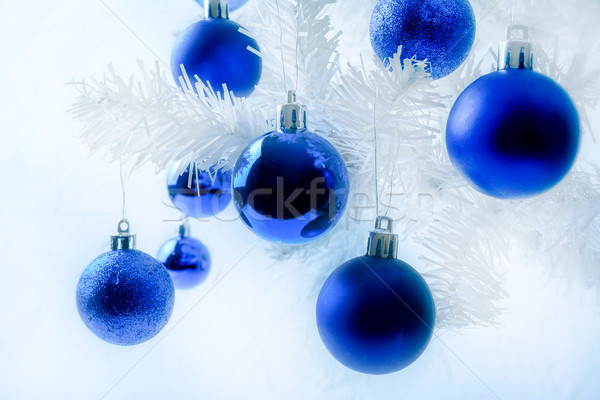 White artificial fir branches with blue ornaments Stock photo © TasiPas