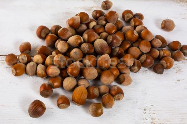 Hazelnuts on white wooden background Stock photo © TasiPas