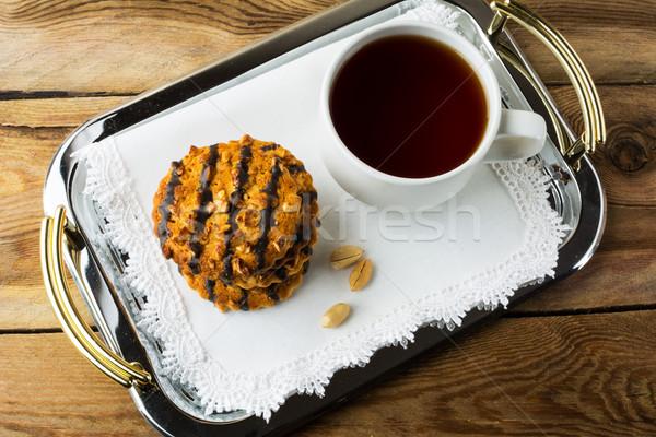 Arachidi cookies cioccolato Cup tè metal Foto d'archivio © TasiPas