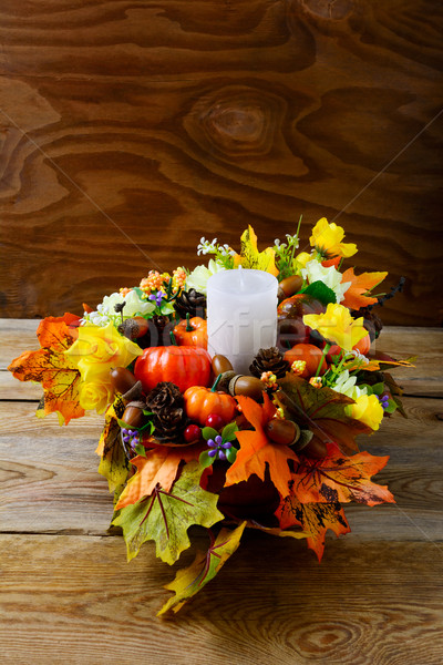 Fall table centerpiece with candle and silk maple leaves, vertic Stock photo © TasiPas