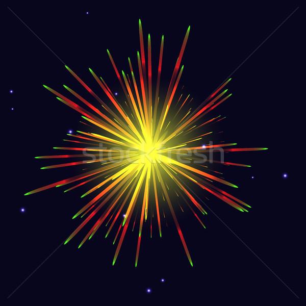 Radiant golden red green fireworks over night sky Stock photo © TasiPas