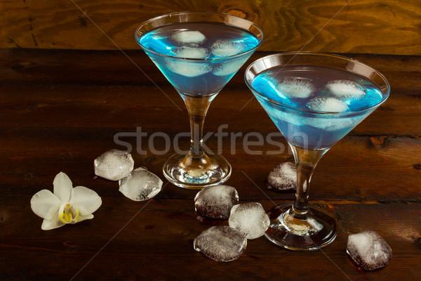Azul cóctel martini gafas licor frutas Foto stock © TasiPas