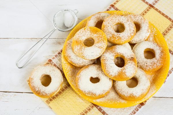 Homemade donuts on yellow plate Stock photo © TasiPas