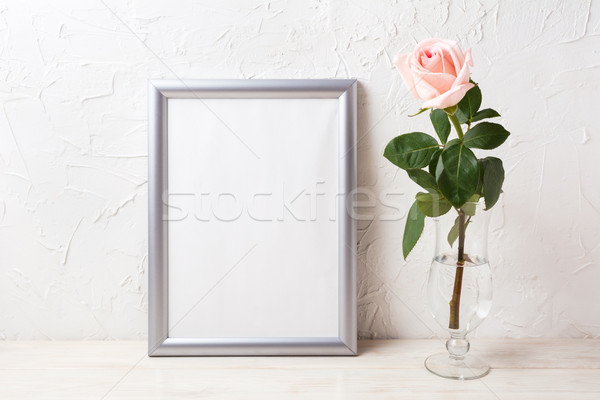 Silver frame mockup with soft pink rose in exquisite vase Stock photo © TasiPas