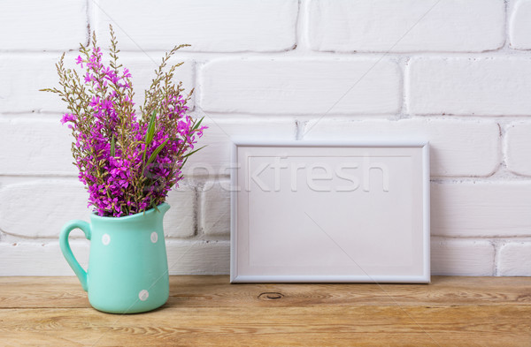 White frame mockup with maroon purple flowers in mint pitcher Stock photo © TasiPas