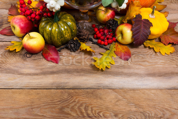 Fall background with green pumpkin, yellow squash, oak leaves, c Stock photo © TasiPas