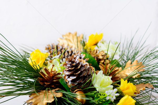 Christmas greenery with golden cones and yellow silk roses  Stock photo © TasiPas