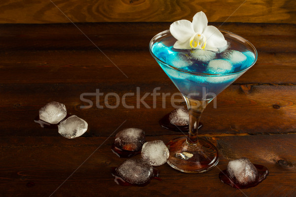 синий коктейль служивший орхидеи Martini ликер Сток-фото © TasiPas