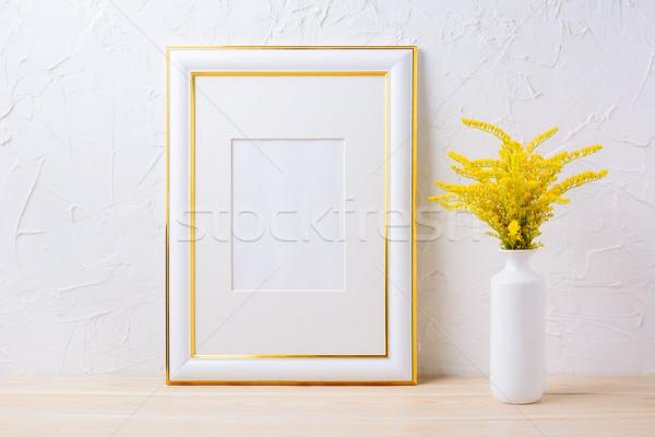 Altın dekore edilmiş çerçeve sarı Stok fotoğraf © TasiPas