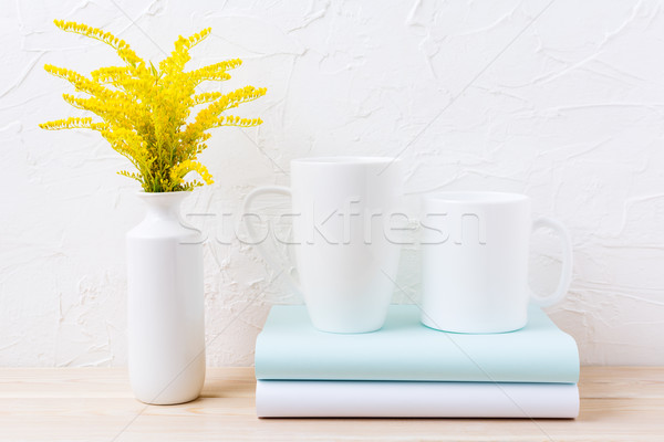Two white coffee and cappuccino mug mockup with ornamental grass Stock photo © TasiPas