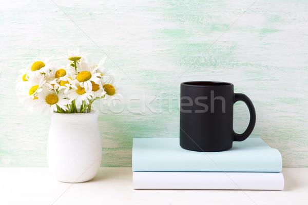 черный кофе кружка белый области ромашка Сток-фото © TasiPas