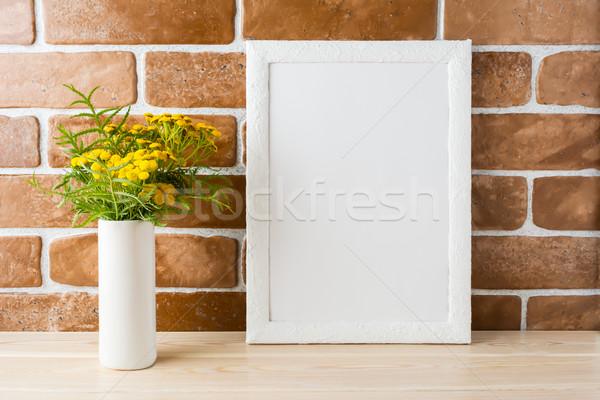 Fehér keret vázlat sárga virágok védtelen tégla Stock fotó © TasiPas