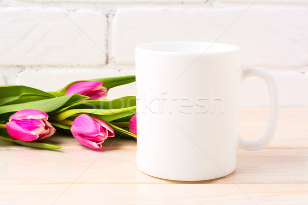 White coffee mug mockup with magenta pink tulips bouquet Stock photo © TasiPas