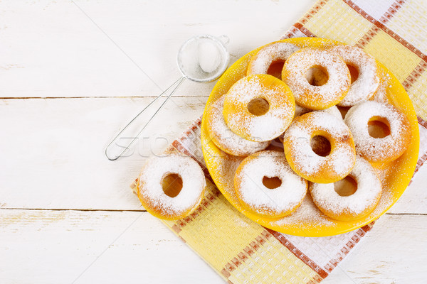 Donuts served on yellow plate top view copy space Stock photo © TasiPas