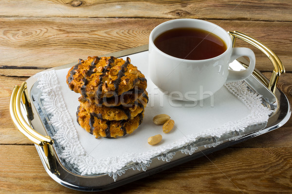 Chocolate icing cookies with peanuts Stock photo © TasiPas